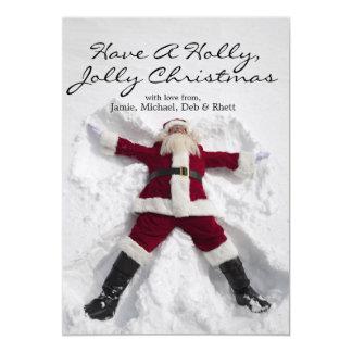 Santa Claus making snow angel outdoors Card