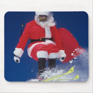 Santa Claus on skis jumping off a cornice at Mouse Pad