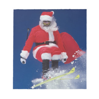 Santa Claus on skis jumping off a cornice at Notepad