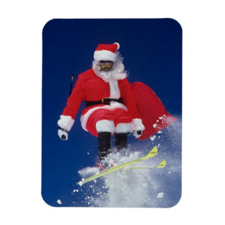 Santa Claus on skis jumping off a cornice at Rectangular Photo Magnet