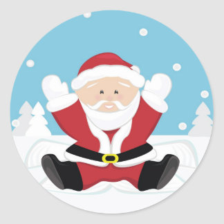 Santa Claus playing on snow. Classic Round Sticker