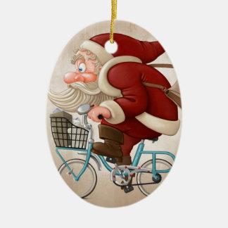 Santa Claus rides the bicycle Christmas Ornament