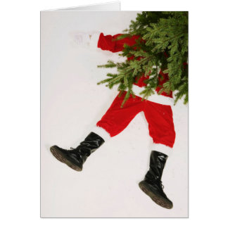 Santa Claus underneath Christmas tree Greeting Card