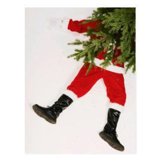 Santa Claus underneath Christmas tree Postcard