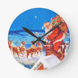 Santa Claus Up On The Rooftop In The Snow Round Clock