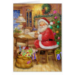 Santa Claus working on his desk Greeting Card