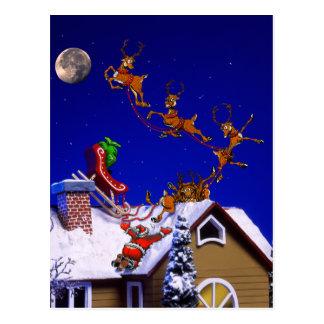 Santa crashing on a rooftop post card