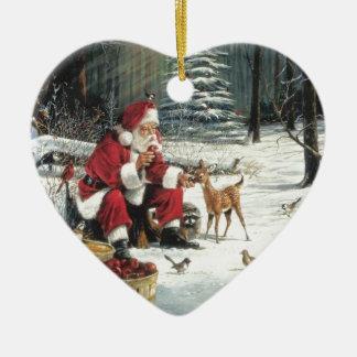 Santa feeding a baby reindeer ornaments