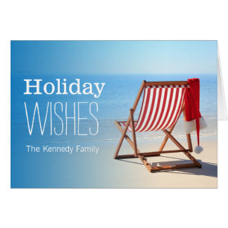 Santa hat on a deck chair. Christmas at the Greeting Card