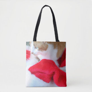 Santa hats with orange and white cat tote bag