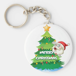 Santa hiding at the back of the christmas tree basic round button key ring
