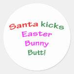 Santa Kicks Easter Bunny Butt! Round Sticker
