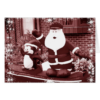 Santa & Penguin Friend Waving Greeting Card