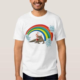 Santa riding a komodo dragon through a rainbow shirt