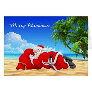 santa sleeping on the beach greeting card