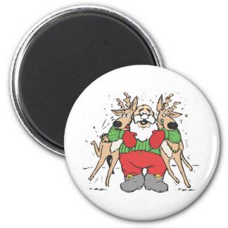 Santa Squeezing two Reindeer's 6 Cm Round Magnet