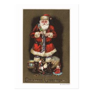 Santa Stuffing Stocking with Nutcracker Postcard