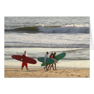 Santa's and the surfer girls greeting card