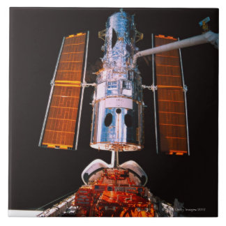 Satellite Docked on Space Shuttle Tile