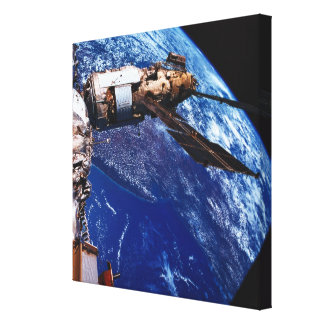 Satellite Orbiting in Space Canvas Print
