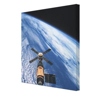 Satellite Orbiting Space Canvas Print