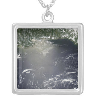 Satellite view of oil leaking silver plated necklace
