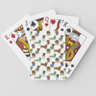 Sausage dogs / dachshunds with jumpers playing cards