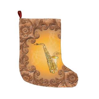 Saxophone with key notes large christmas stocking