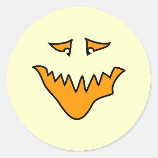 Scary Face. Orange Monster Grin. Round Sticker