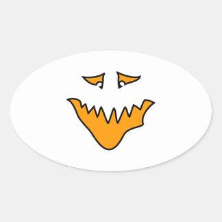 Scary Face. Orange Monster Grin. Oval Sticker