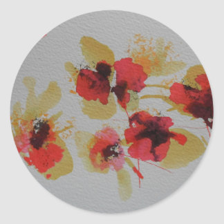 Scatter of scarlet red poppy flowers classic round sticker