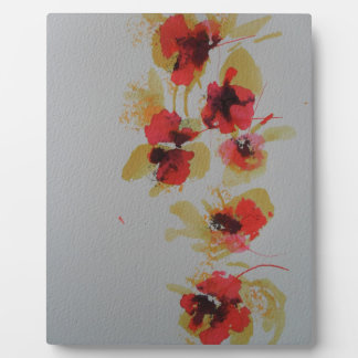 Scatter of scarlet red poppy flowers plaque