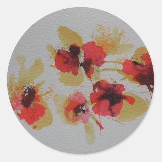 Scatter of scarlet red poppy flowers round sticker