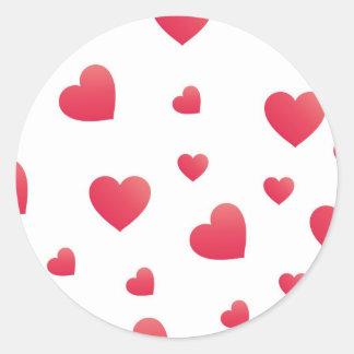 Scattered hearts round sticker