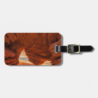 Scenic of eroded sandstone cave luggage tag