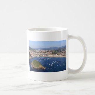 Scenic view of beautiful San Sebastian coastline Mugs