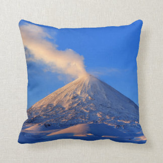 Scenic winter volcanic eruption at sunrise cushion