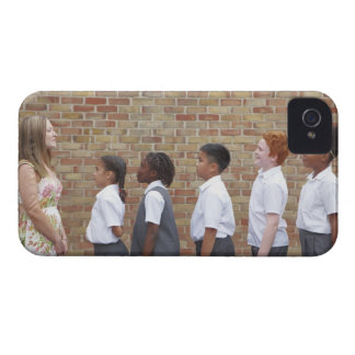 School children lining up in the playground for iPhone 4 cover
