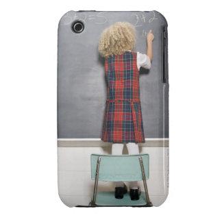 School girl (6-7) writing on blackboard, iPhone 3 Case-Mate cases