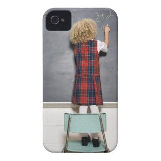 School girl (6-7) writing on blackboard, Case-Mate iPhone 4 cases