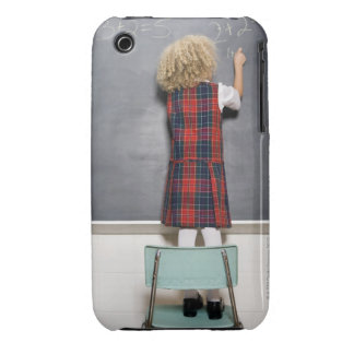School girl (6-7) writing on blackboard, iPhone 3 Case-Mate case
