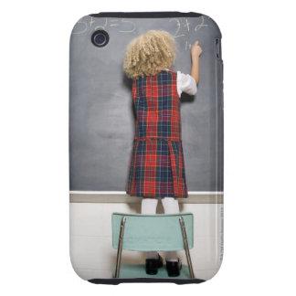School girl (6-7) writing on blackboard, iPhone 3 tough case