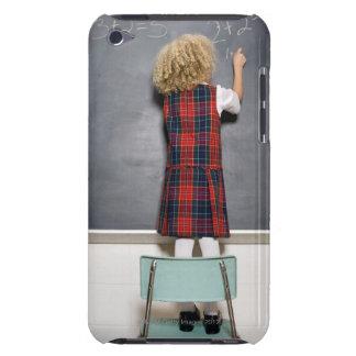 School girl (6-7) writing on blackboard, iPod touch Case-Mate case