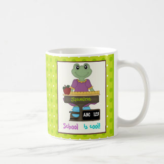 School is cool! Frog at her desk Back to school Coffee Mug