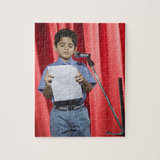 Schoolboy giving speech on a stage jigsaw puzzle