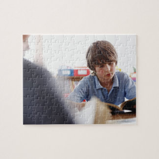 schoolboy reading in classroom jigsaw puzzle