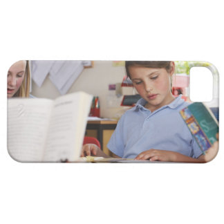 schoolgirl concentrating on reading in class iPhone 5 cover