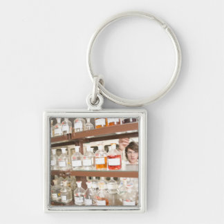 Science student in classroom key ring