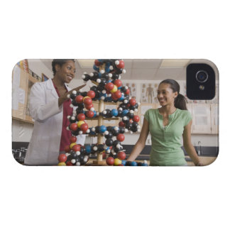 Science teacher and teenage girl looking at iPhone 4 case