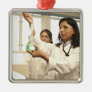 Scientist adding solution to beaker christmas ornament
